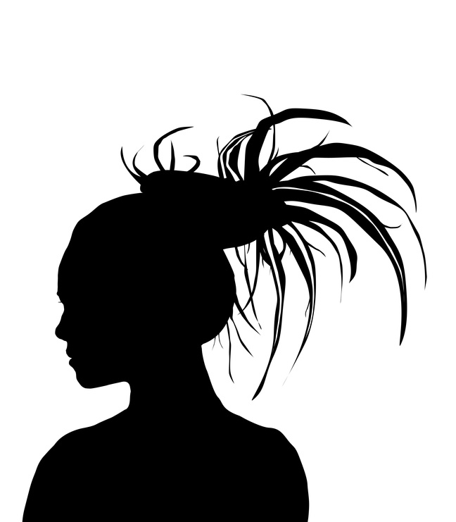 silhouette of woman with dreadlocks